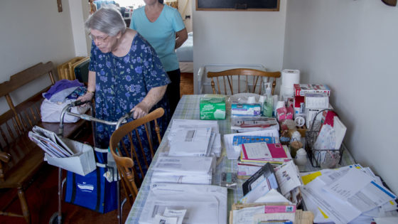 CAPTION CORRECTION - ELIMINATES THE NEIGHBORHOOD AT SUBJECT'S REQUEST  Mary Casavecchia, 87, under the watchful eye of her daughter Linda, 57, walk past the dining room table with all of MaryÕs bills and correspondences neatly organized as they head to the kitchen August 24, 2016.  Many families with older parents are having difficult discussions on when itÕs appropriate for the parents to move out of the house and into some sort of assisted leaving arrangement.  CLEM MURRAY / Staff Photographer